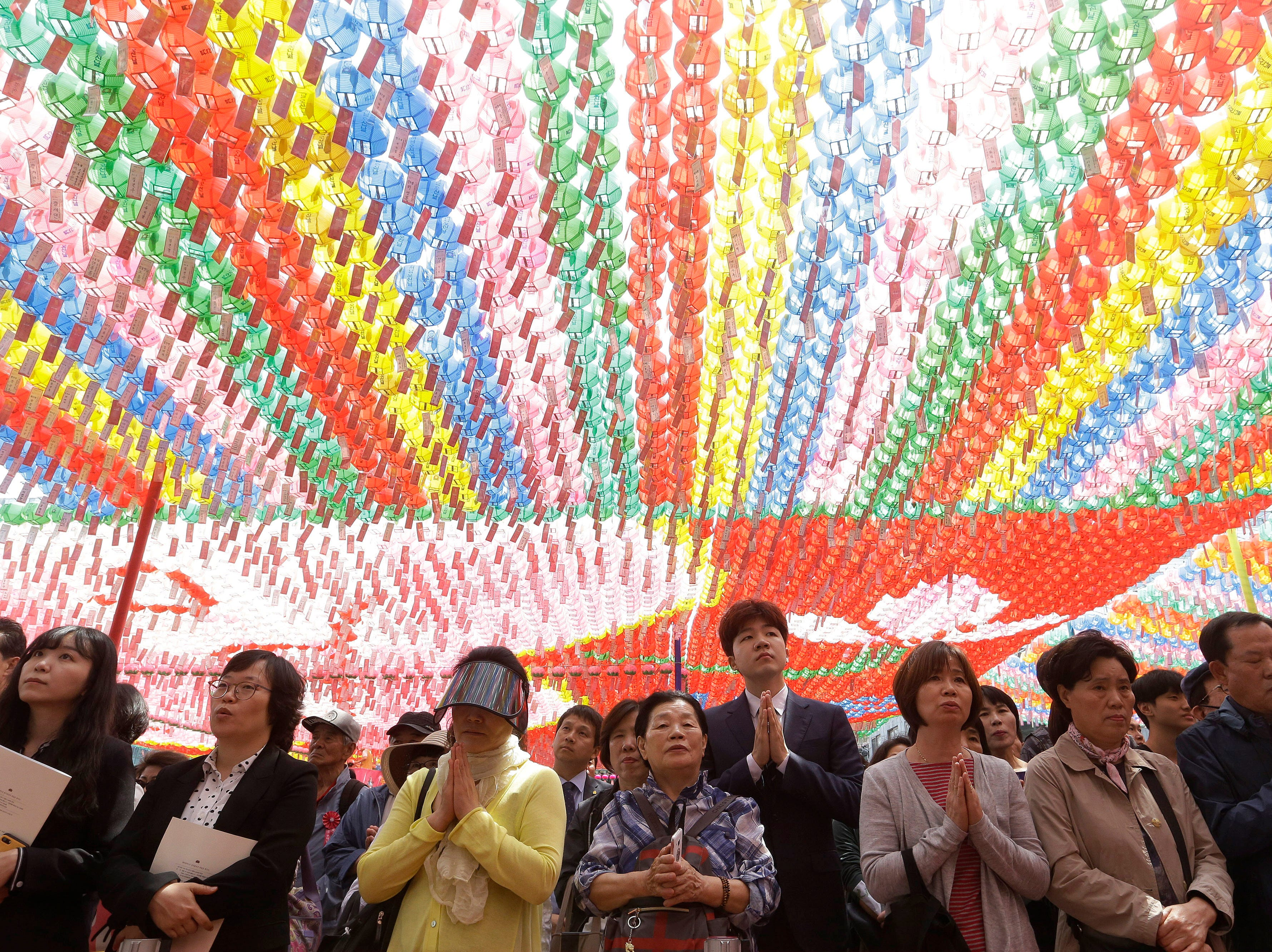 Buddhists pray during a service to celebrate Buddha's birthday at the Jogye temple in Seoul, South Korea, Sunday, May 12, 2019. Buddhists visit the temple across the country to celebrate the Buddha's birthday.
