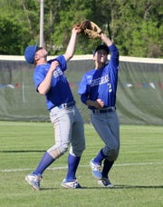 Horseheads first baseman Max Keagle, left, catches the ball next to Grayson Woodhouse on May 11, 2019 against Corning at Corning-Painted Post High School.