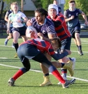Adarshpal Singh of the Corning under-19 boys rugby club controls the ball in a 27-10 winner over Fairport on May 11, 2019 at Corning Memorial Stadium.