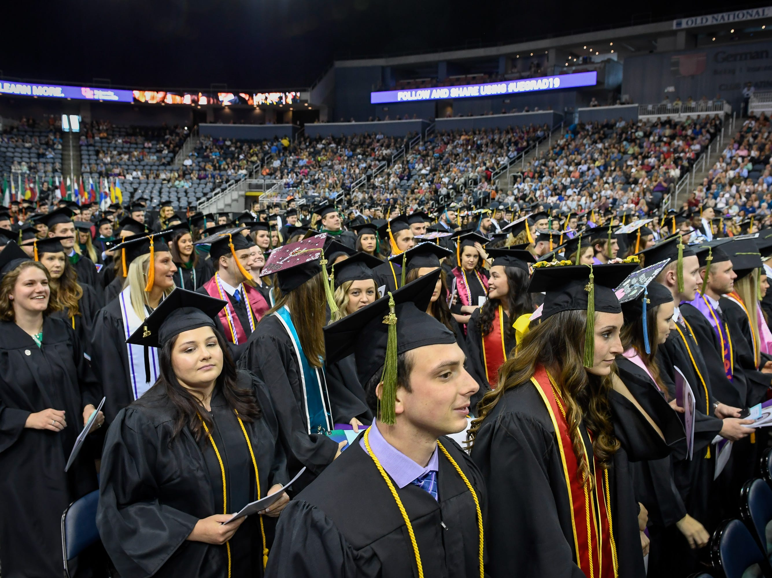 Graduates come to their feet during the University of Evansville's 161st commencement ceremony held at the Ford Center Saturday, May 11, 2019.
