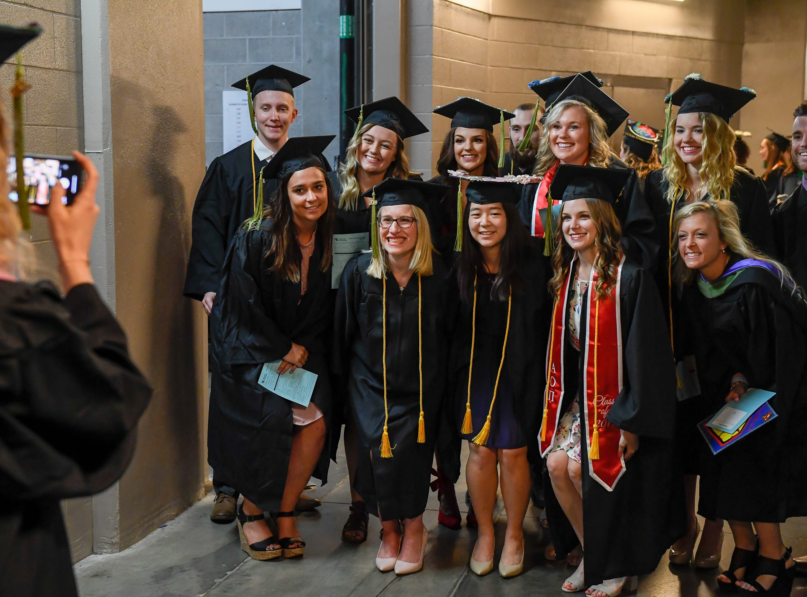Graduates taking photos in the tunnel before the University of Evansville's 161st commencement ceremony held at the Ford Center Saturday, May 11, 2019.