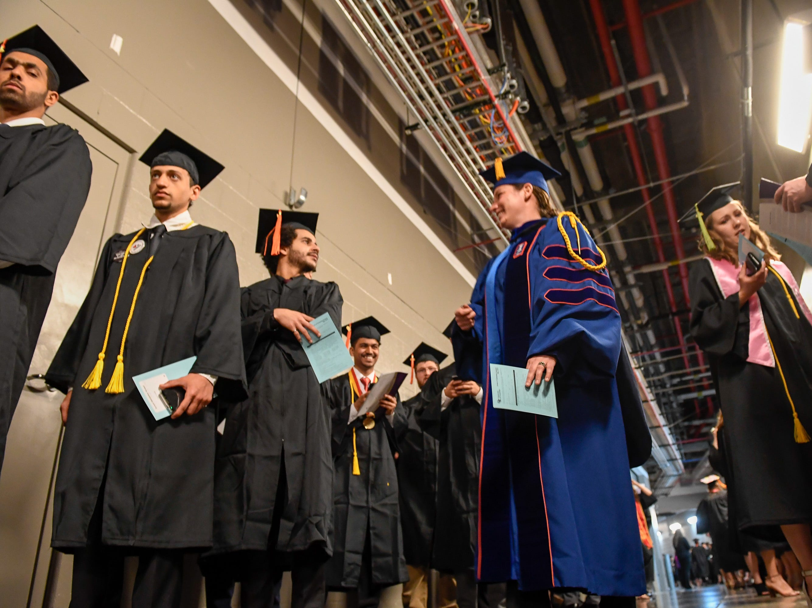 Facility and students wait in the tunnel before the start the University of Evansville's 161st commencement ceremony held at the Ford Center Saturday, May 11, 2019.