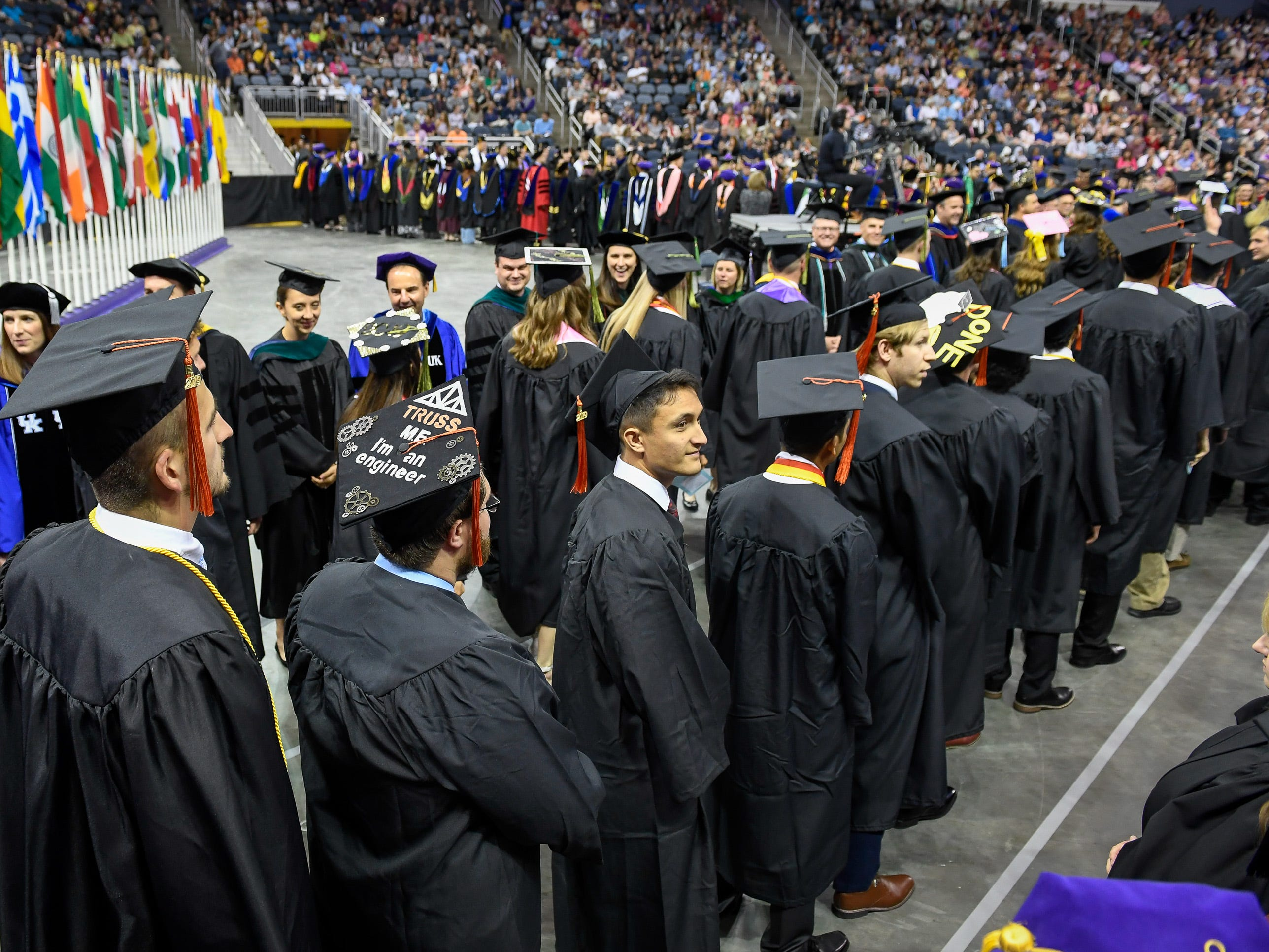 Graduates file on to the arena floor for the University of Evansville's 161st commencement ceremony held at the Ford Center Saturday, May 11, 2019.
