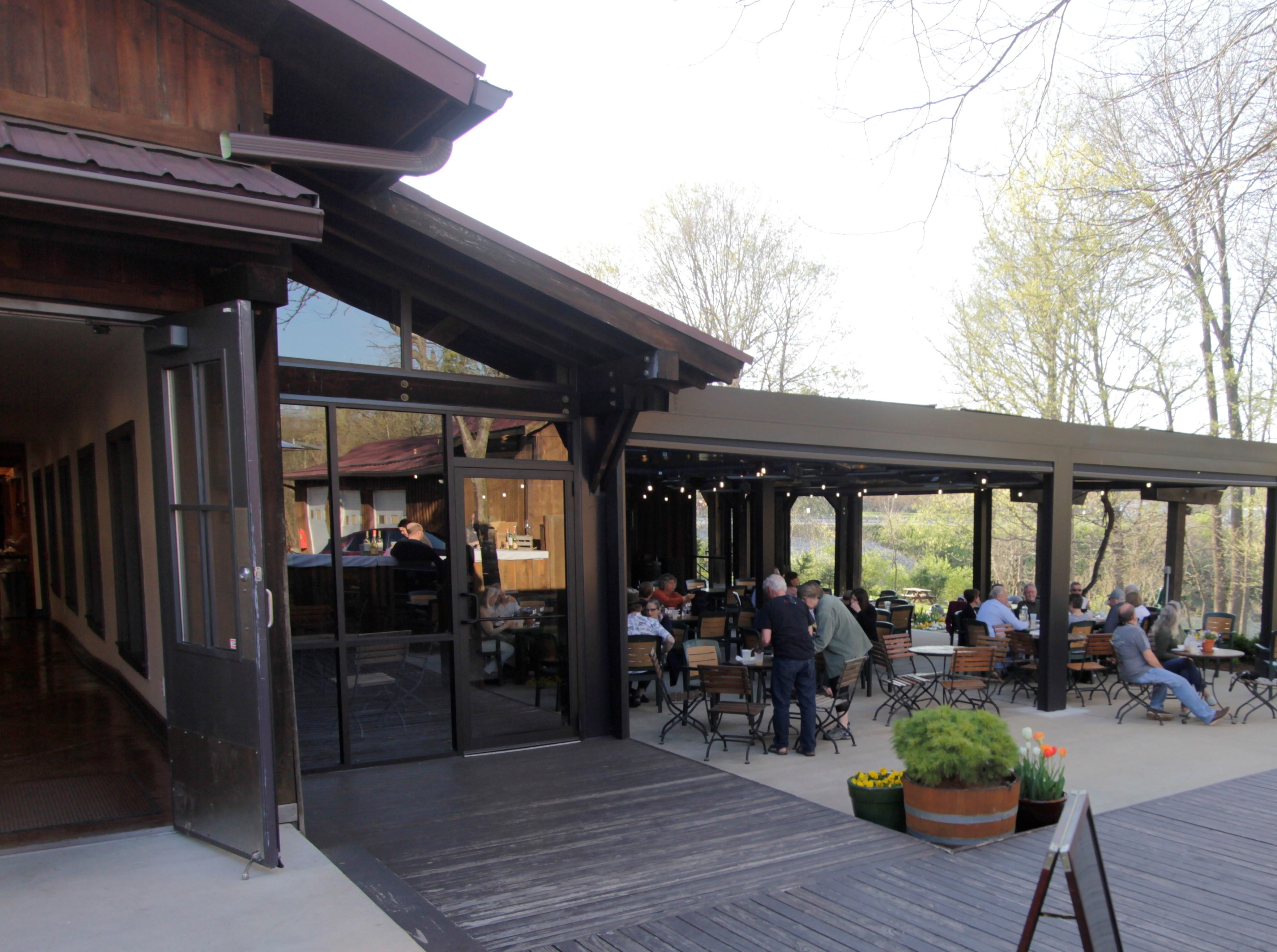 Wine drinkers enjoy a spring day on the patio  at Oliver Winery in Bloomington.