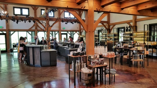 The Oliver Winery tasting room, recently remodeled, with a new bar and large windows overlooking the grounds.