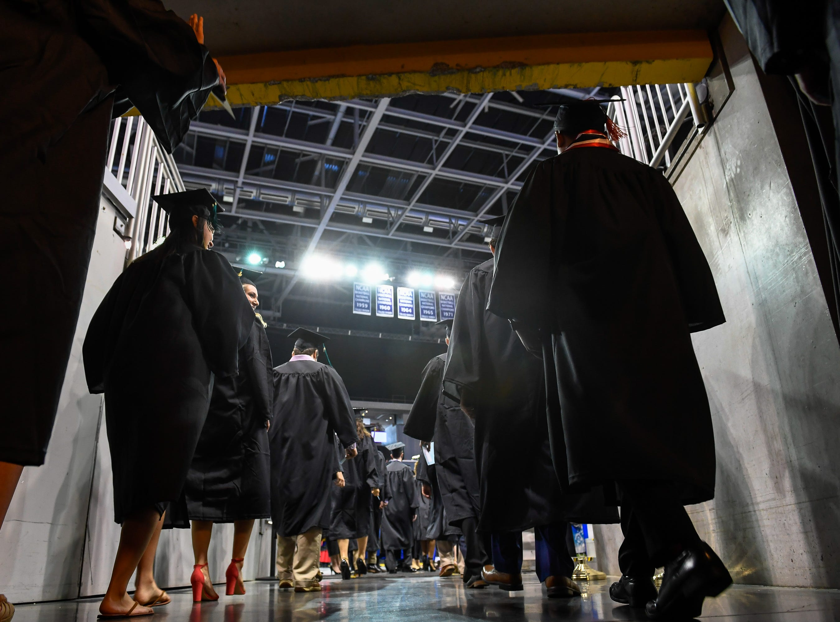Graduates leave the tunnel during the opening procession during the University of Evansville's 161st commencement ceremony held at the Ford Center Saturday, May 11, 2019.