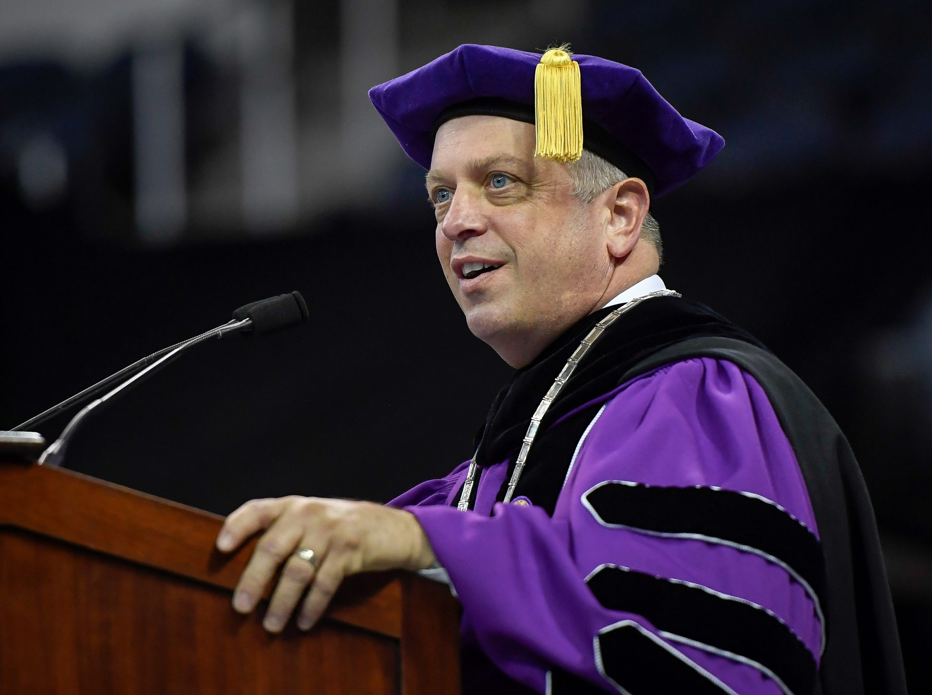 University of Evansville President Mr. Christopher Pietruszkiewicz addresses graduates, family and friends attending the school's 161st commencement ceremony held at the Ford Center Saturday, May 11, 2019.