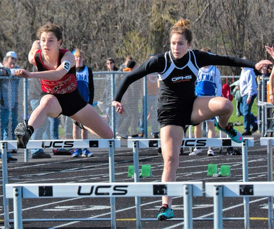 Aubrey DeBauche of Gillett and Kari Albrecht of Oconto Falls, finished second and first, respectively, in the 100 M Hurdles at the Oconto County Meet on May 6.