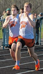 Aaron Gonnering, right, of Oconto Falls  and Keeshawn Katers placed first and second in the 100 meter dash at the County meet in Oconto on May 6. Teammate Owen Huber was third.