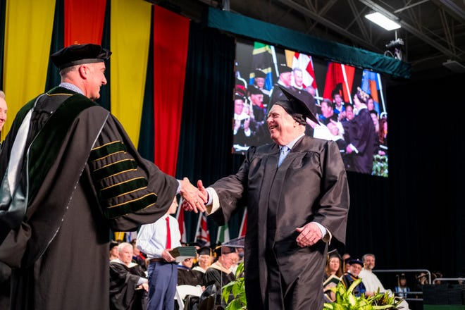 Tom Durkin graduated from St. Norbert College on Sunday.