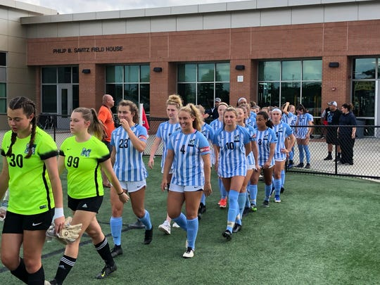The J.L. Mann girls soccer team enters the playing area Saturday at Irmo High School in Columbia. The Patriots left with their third straight state championship.
