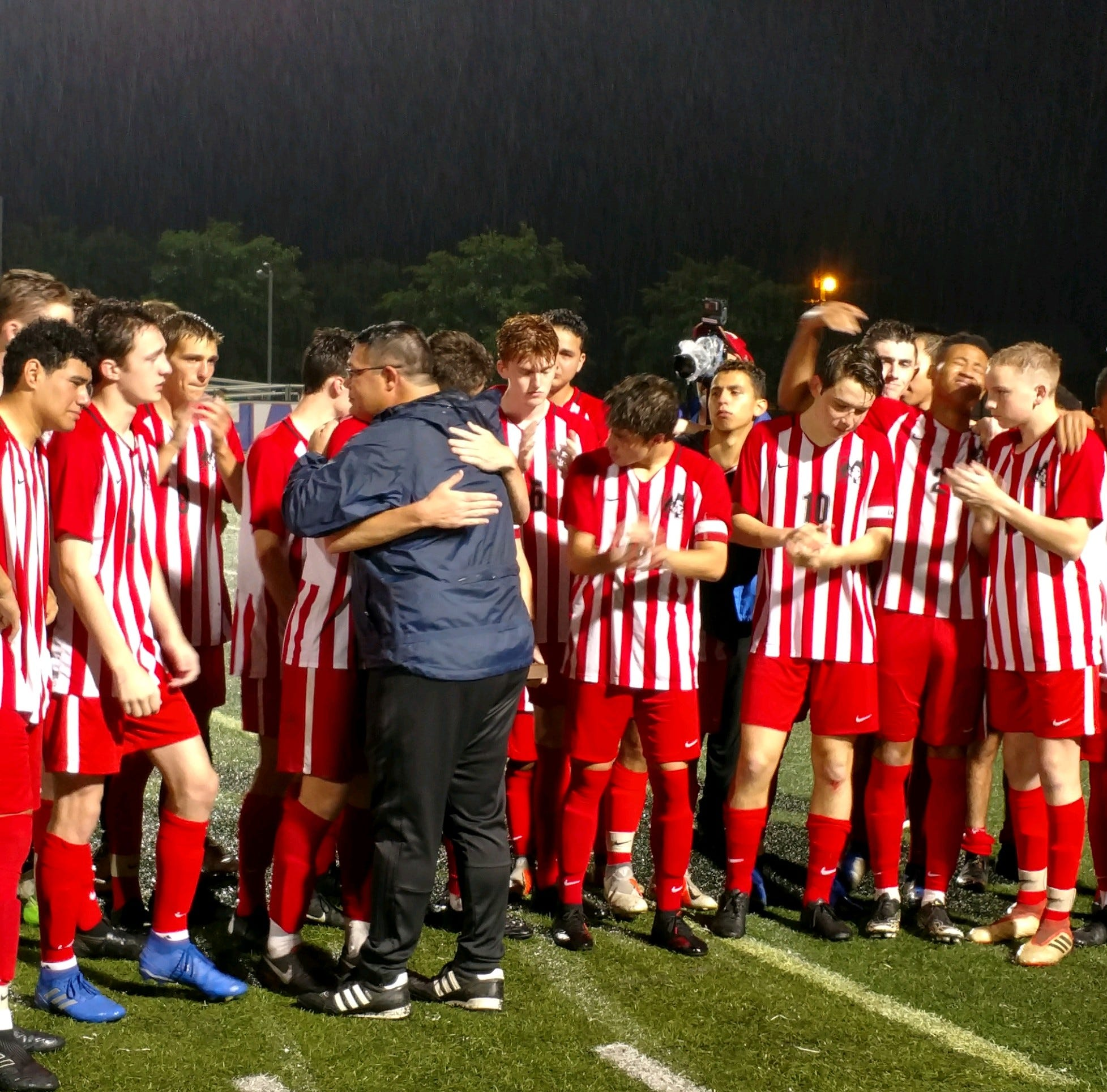 The J.L. Mann boys soccer team gathers after its loss to Wando in three overtimes in the Class AAAAA championship game.