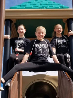 Double Dream Team jump ropers Brie Srb, left, Janica Clark, center, and Ashlyn Jarrett, right, qualified for a national competition in Orlando.