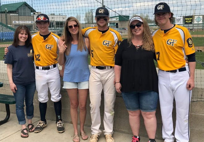 Three members of the Great Falls Chargers help to celebrate Mothers Day with their respective moms prior to Sunday's game against the Tri County Cardinals. Left to right are Deb and Derick Spring, Diane and Josh Lowery, and Tammy McClary and Braden Hirst