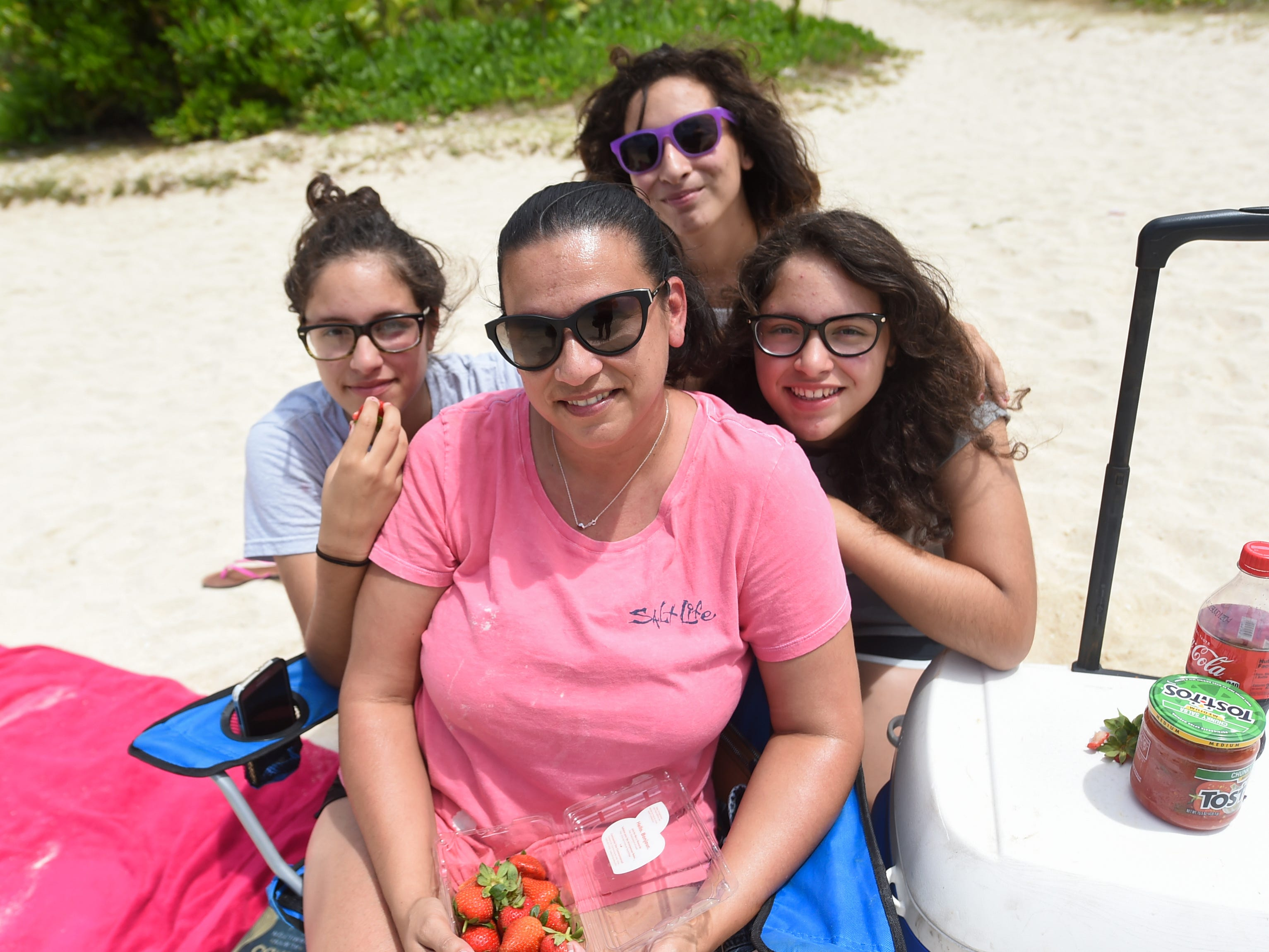 Betty Reyes relaxes at a Tumon beach with her daughters Daniella, left, Victoria, top, and Gabriella on Mother's Day, May 12, 2019.