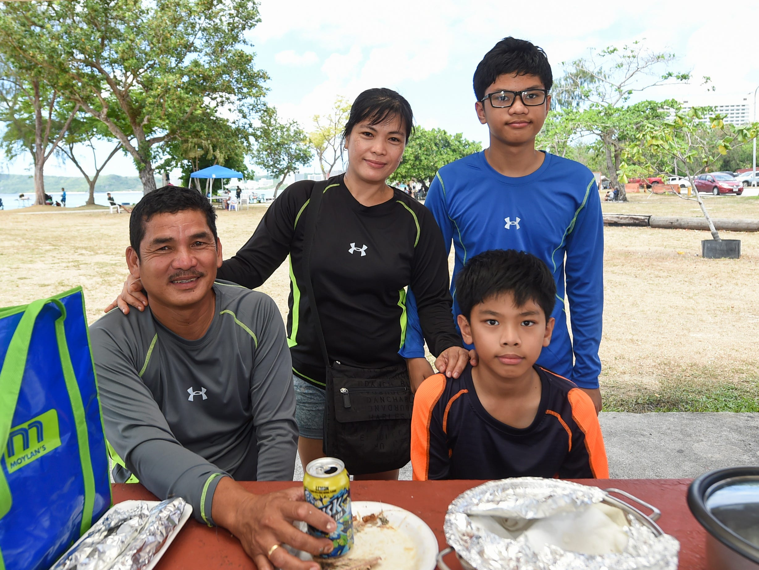 Patricia and Domingo Mungcal celebrates Mother's Day with their boys Joshua, 13, and Jaisen, 11, seated, at the Gov. Joseph Flores Beach Park in Tumon, May 12, 2019.