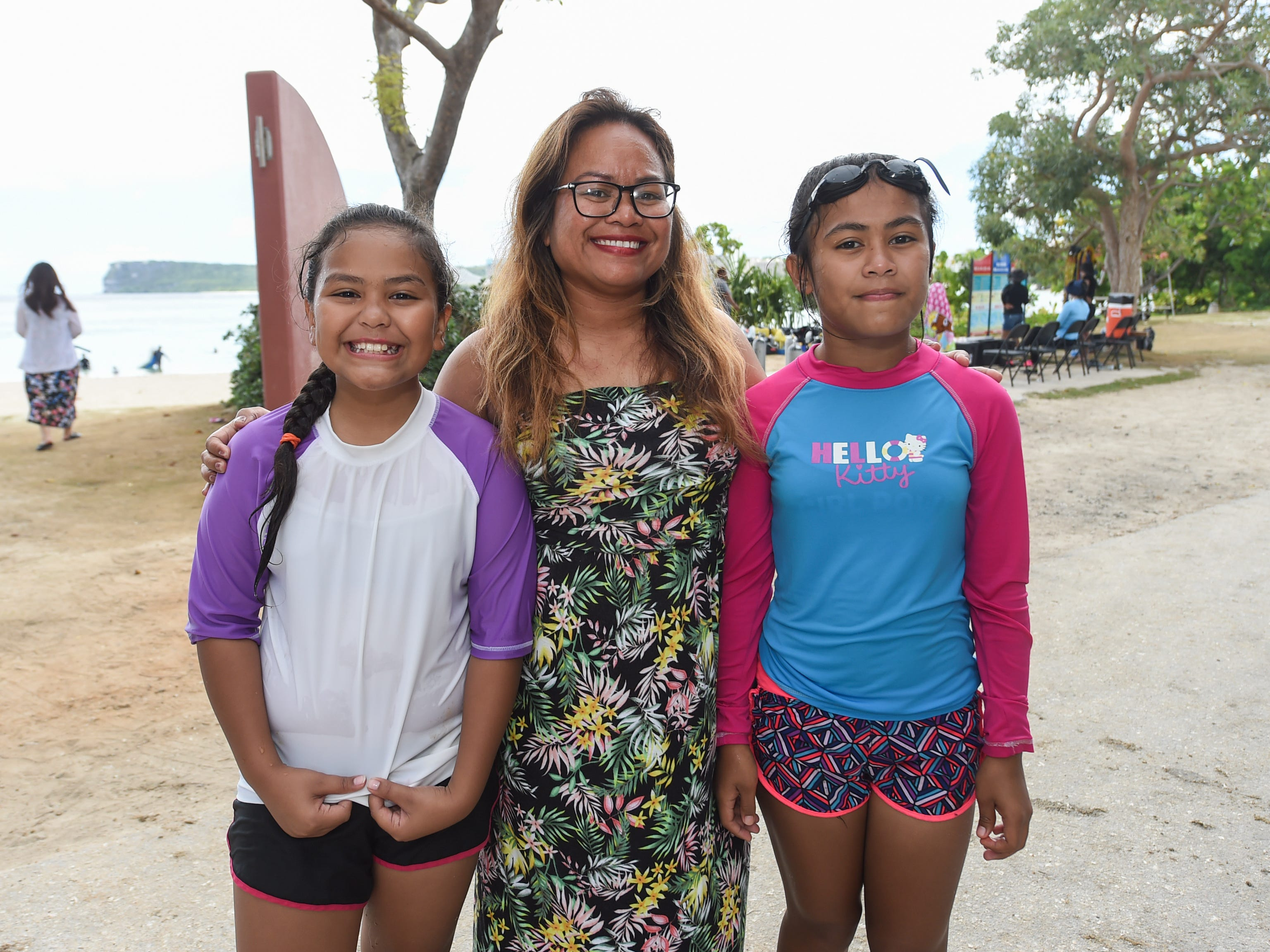 Resa Saddo spends Mother's Day with her daughters Arielle, 9, left, and Bella, 11, at the Gov. Joseph Flores Beach Park in Tumon, May 12, 2019.