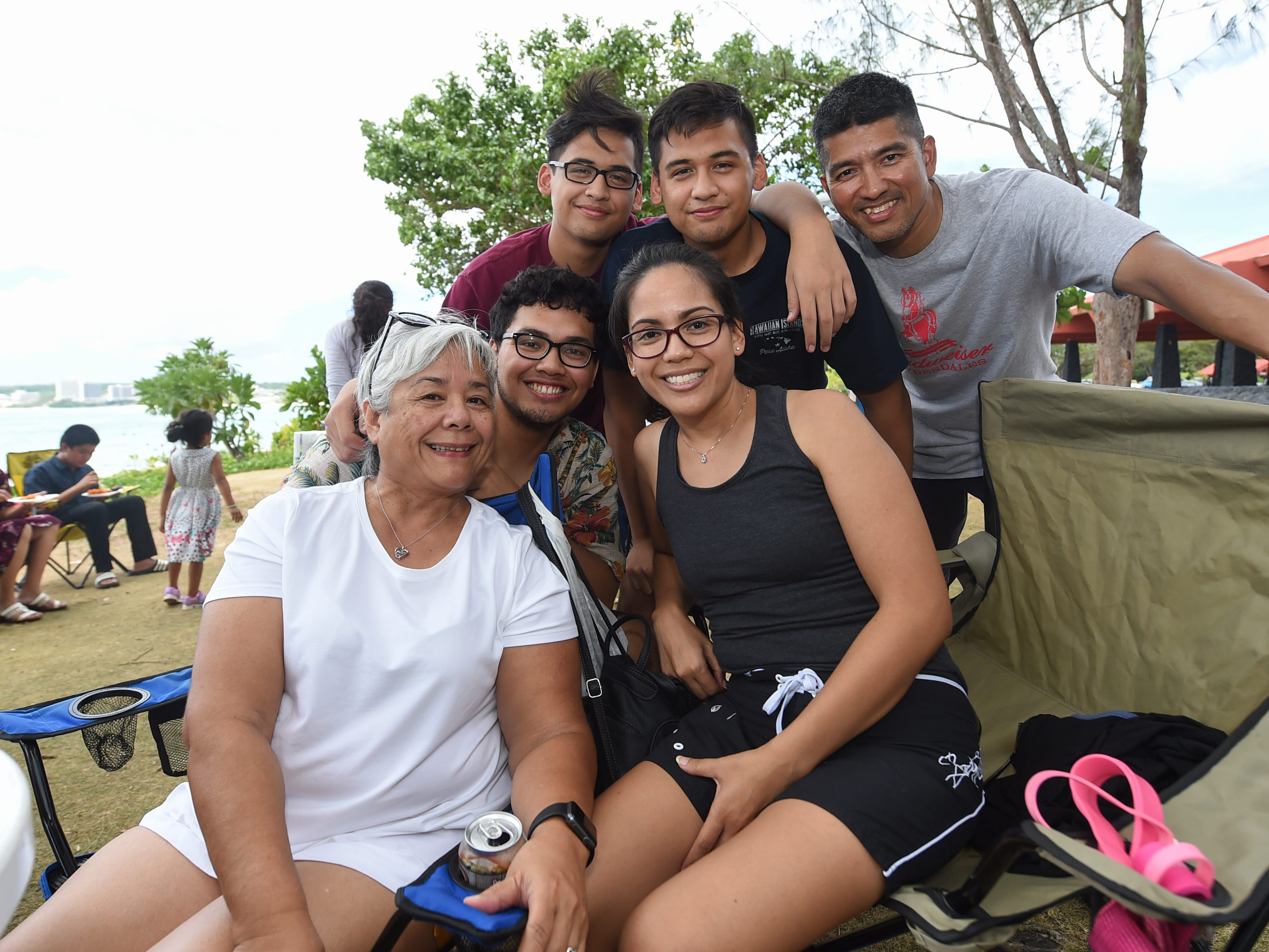 Families gather at the Gov. Joseph Flores Beach Park in Tumon to spend Mother's Day with their loved ones on May 12, 2019. Top row from left: Damien Dela Cruz, Dillen Dela Cruz, and Daniel Dela Cruz. Bottom row from left: Julia Pocaigue, Darien Dela Cruz, and Deidra Dela Cruz.