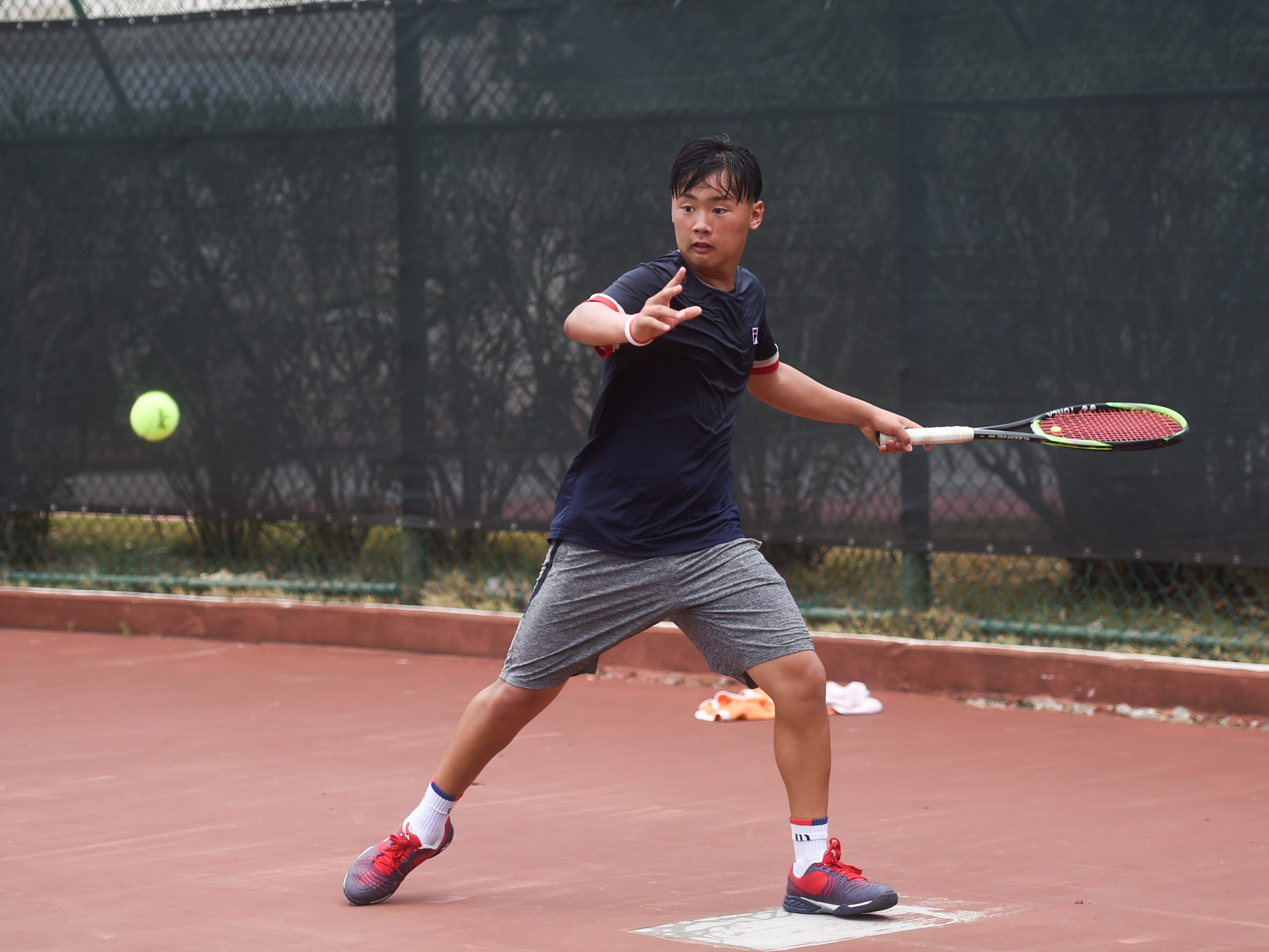 Seungik Park competes during a 2019 Chuck E Cheese ITF World Tennis Tour Juniors qualifying match at the Hilton Guam Resort and Spa in Tumon, May 12, 2019.