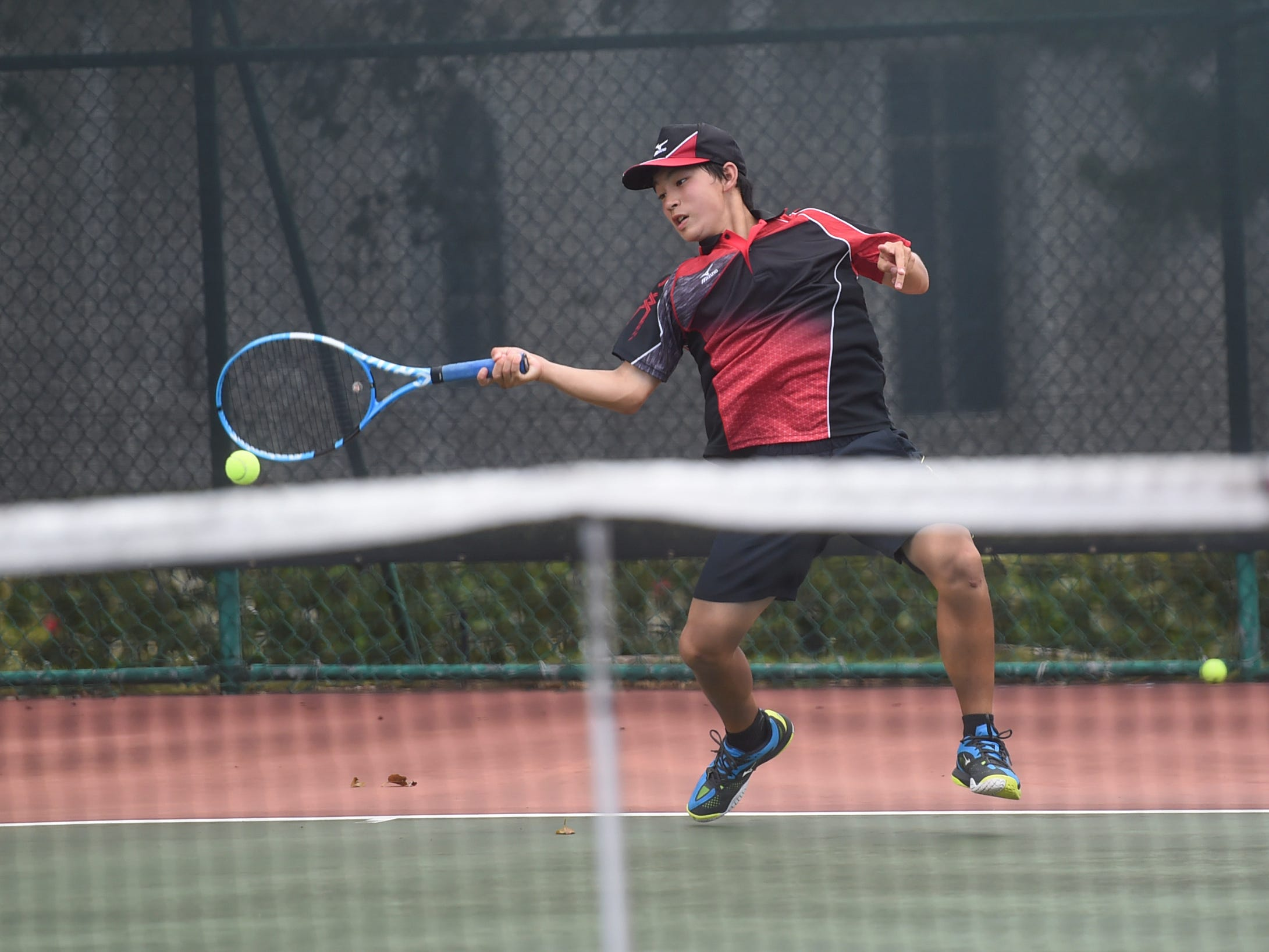 Tomoki Hanahara with a forehand shot during his 2019 Chuck E Cheese ITF World Tennis Tour Juniors qualifying match at the Hilton Guam Resort and Spa in Tumon, May 12, 2019.