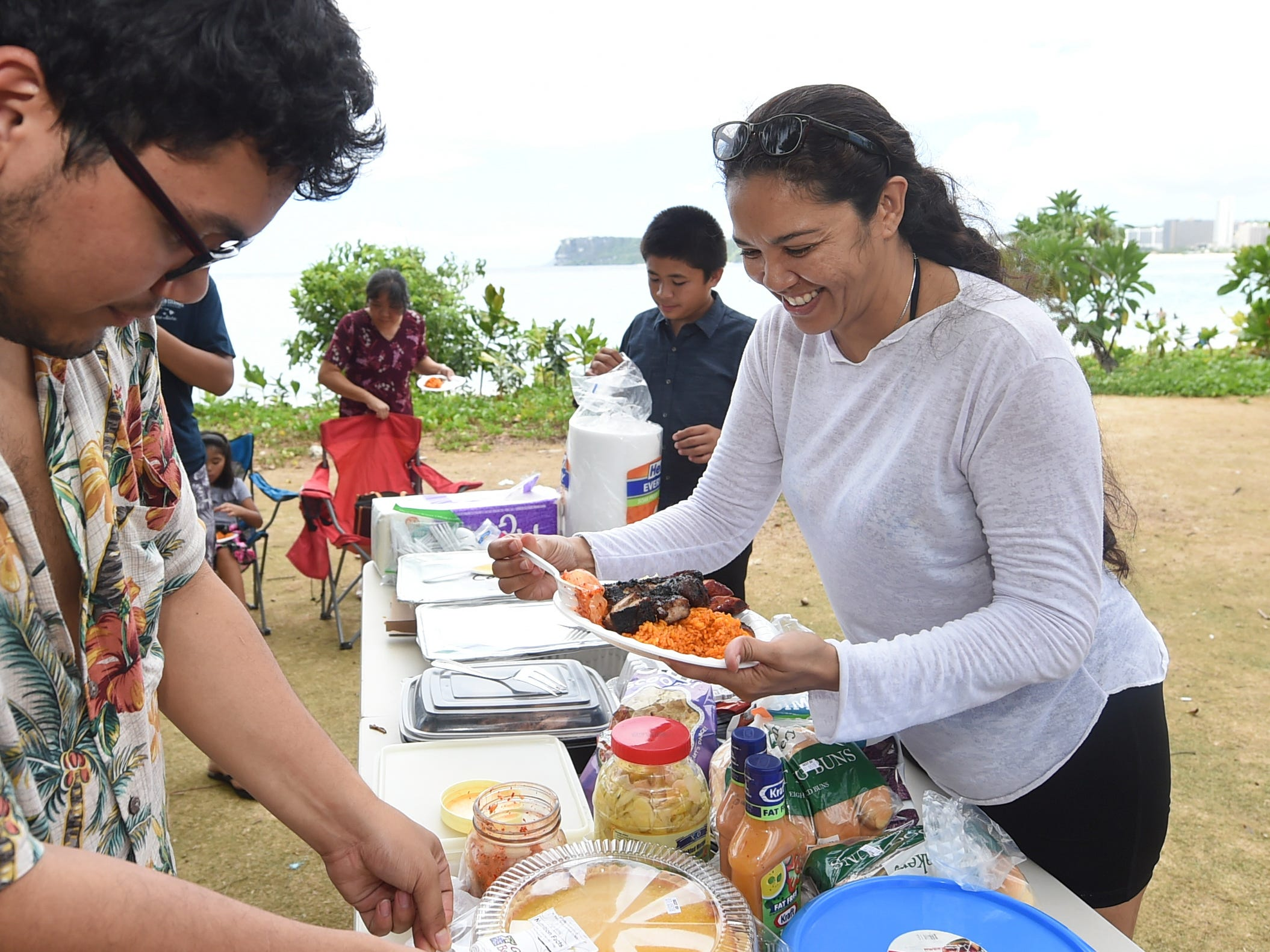 Norma Aguon makes herself a plate of food during a Mother's Day barbecue at the Gov. Joseph Flores Beach Park in Tumon, May 12, 2019.