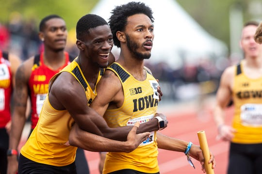 Iowa's Mar'yea Harris, center, gets embraced by teammate Wayne Lawrence Jr. after anchoring in the 4x400 meter relay during the final day of Big Ten track and field outdoor championships, Sunday, May 12, 2019, at Francis X. Cretzmeyer Track on the University of Iowa campus in Iowa City, Iowa. The Hawkeyes won, with a time of 3:07.36.