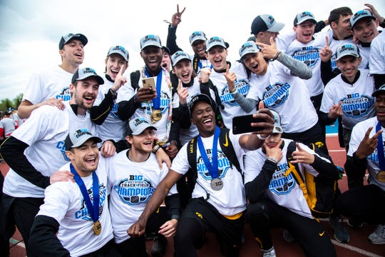 Iowa Hawkeyes men celebrate during the final day of Big Ten track and field outdoor championships, Sunday, May 12, 2019, at Francis X. Cretzmeyer Track on the University of Iowa campus in Iowa City, Iowa.