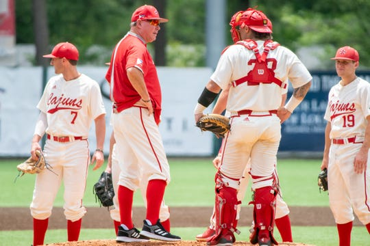 UL coach Tony Robichaux holds a meeting on the mound during last weekend's series against Georgia State.