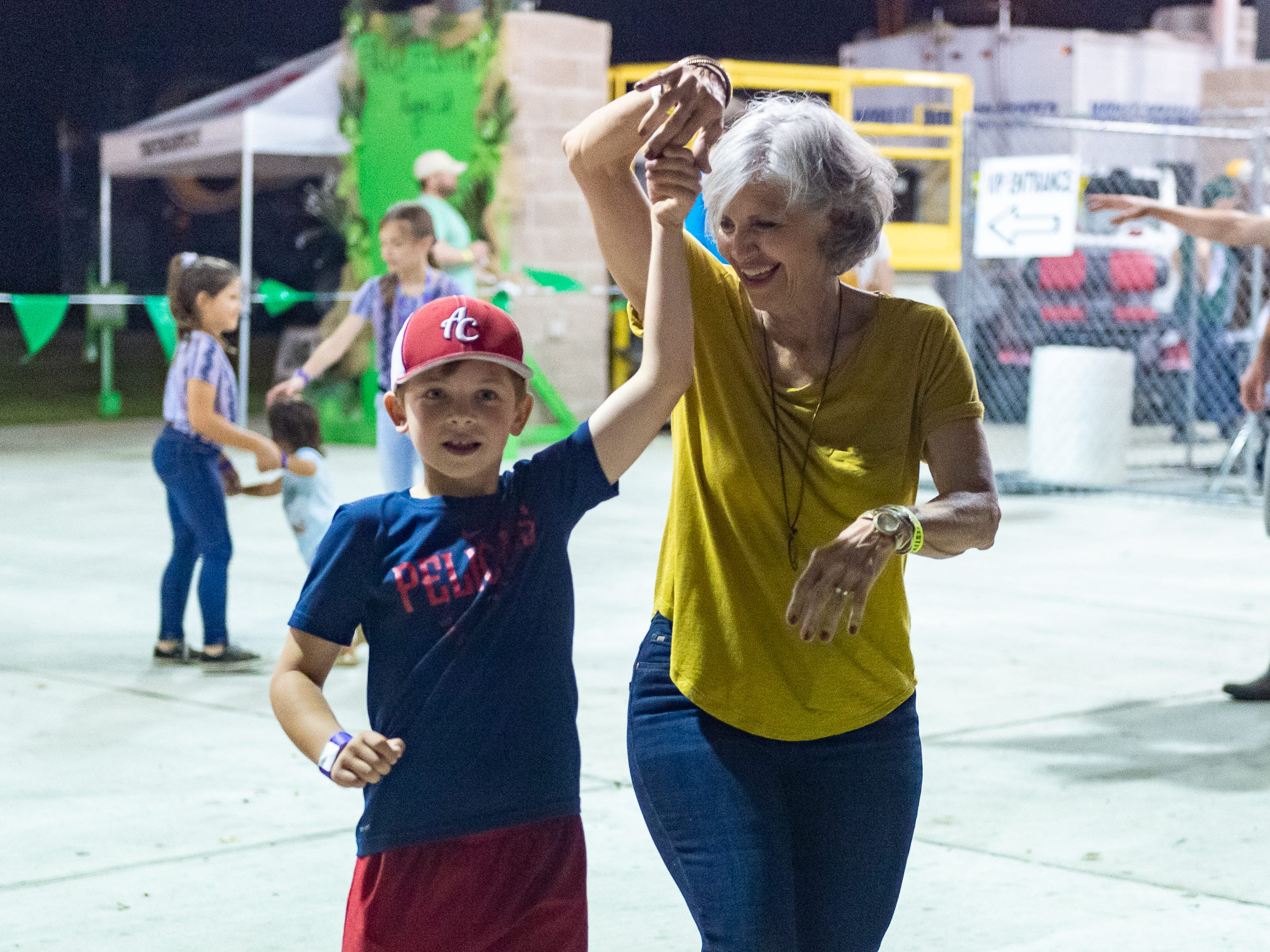 Margaret Doucet dancing with her grandson Brooks Doucet at The Rayne Frog Festival features music, food and events. Friday, May 10, 2019.