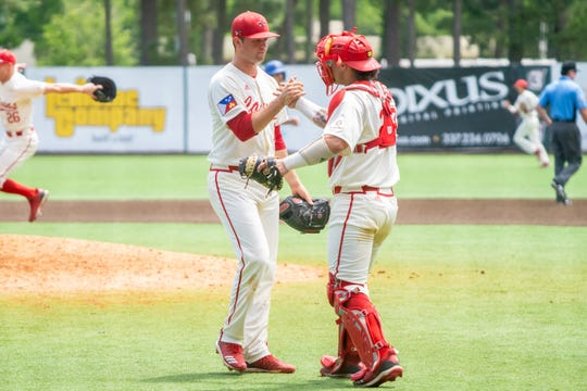 UL seniors Gunner Leger, left, and Handsome Monica, right, celebrate the win after Sunday's 11-5 Senior Day win over Georgia State.