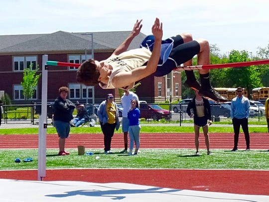 Lancaster's Adam Young competes in the high jump during Saturday's Ohio Capital Conference-Ohio Division championships.