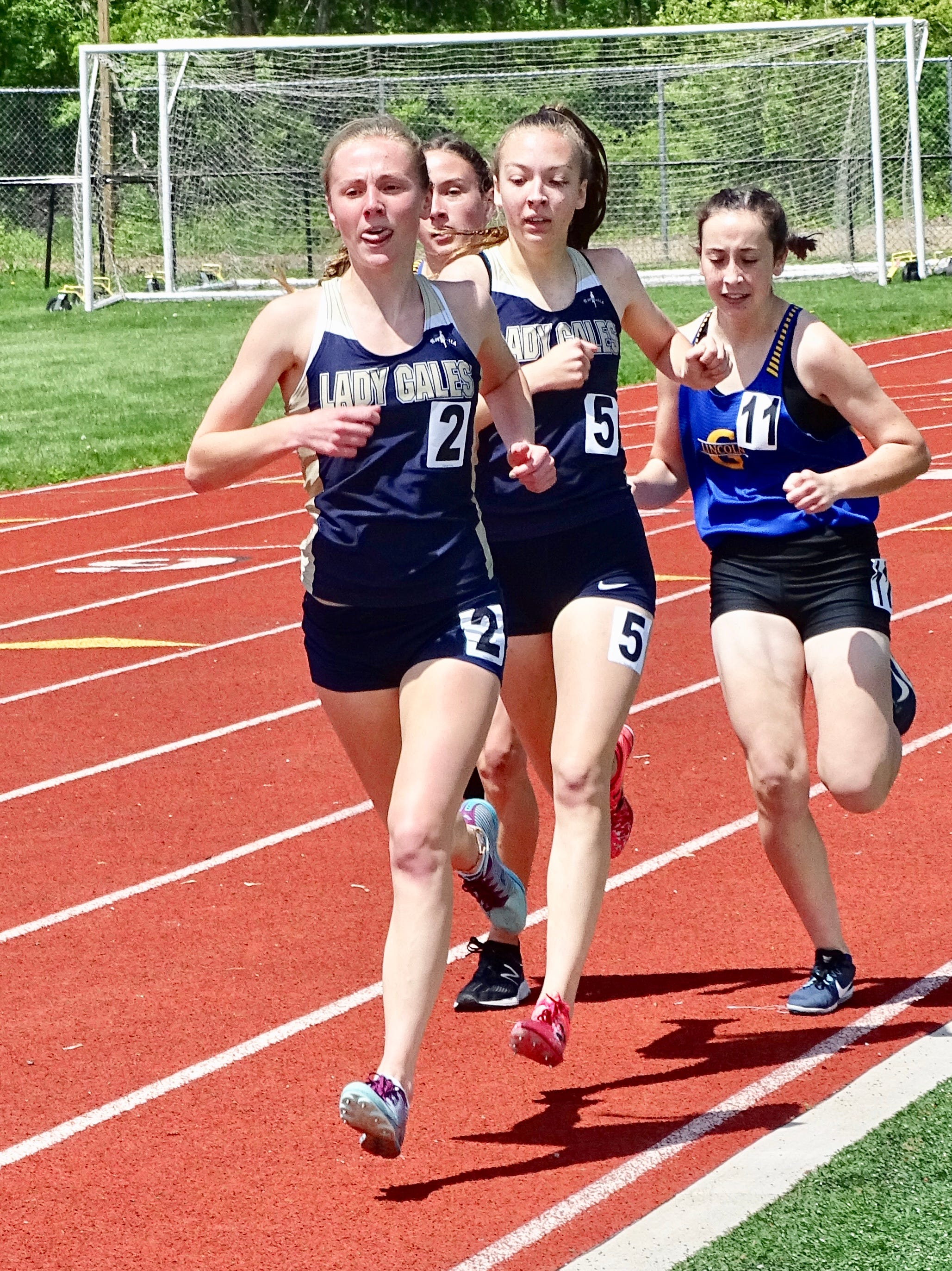 Lancaster's Elise Johnson and Meagan Ward compete in the 1,600 during Saturday's Ohio Capital Conference-Ohio Division championships.