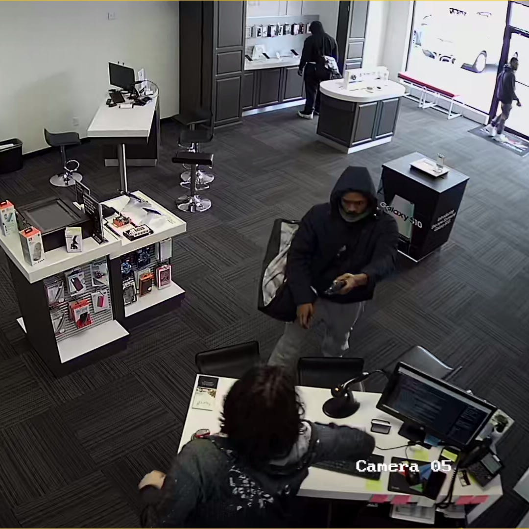 Police are searching for three men who robbed a Verizon store in Delhi Township