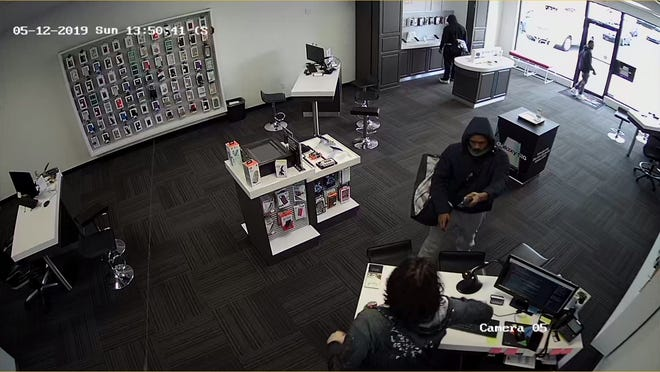 Police are searching for three men who robbed a Verizon store in Delhi Township.