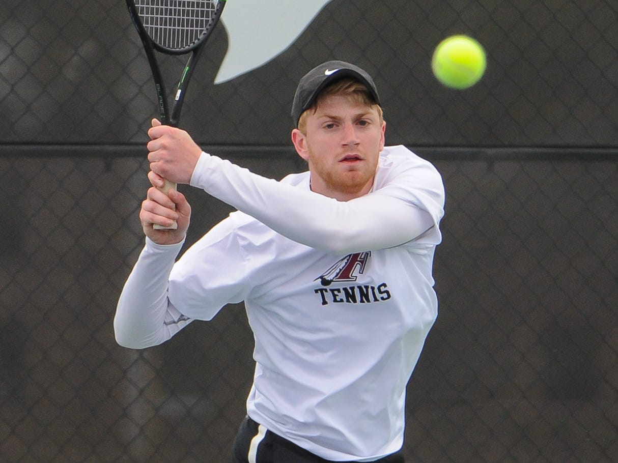 Menomonee Falls senior Alex Budde returns a shot against Wauwatosa East sophomore Noah Viste In the No. 1 singles championship at the Greater Metro Conference boys tennis meet Saturday, May 11, 2019, at Brookfield East High School. Viste won, 6-2, 4-6, 6-4.