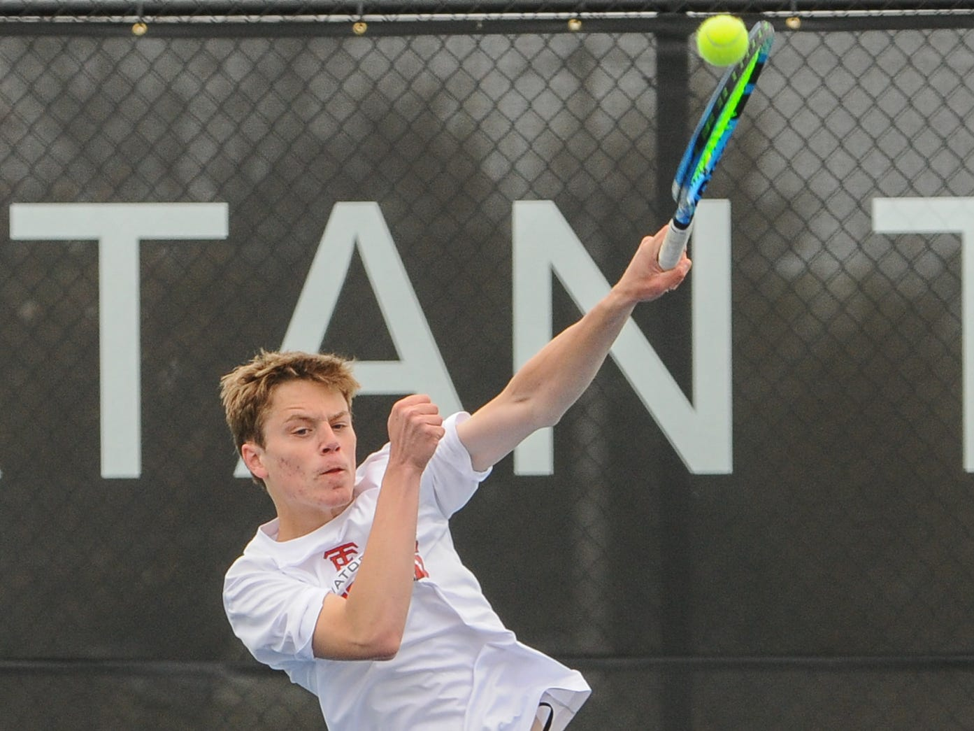 Wauwatosa East sophomore Noah Viste returns a shot from Menomonee Falls senior Alex Budde at the Greater Metro Conference boys tennis meet Saturday, May 11, 2019, at Brookfield East High School. Viste won their No. 1 singles championship match, 6-2, 4-6, 6-4.