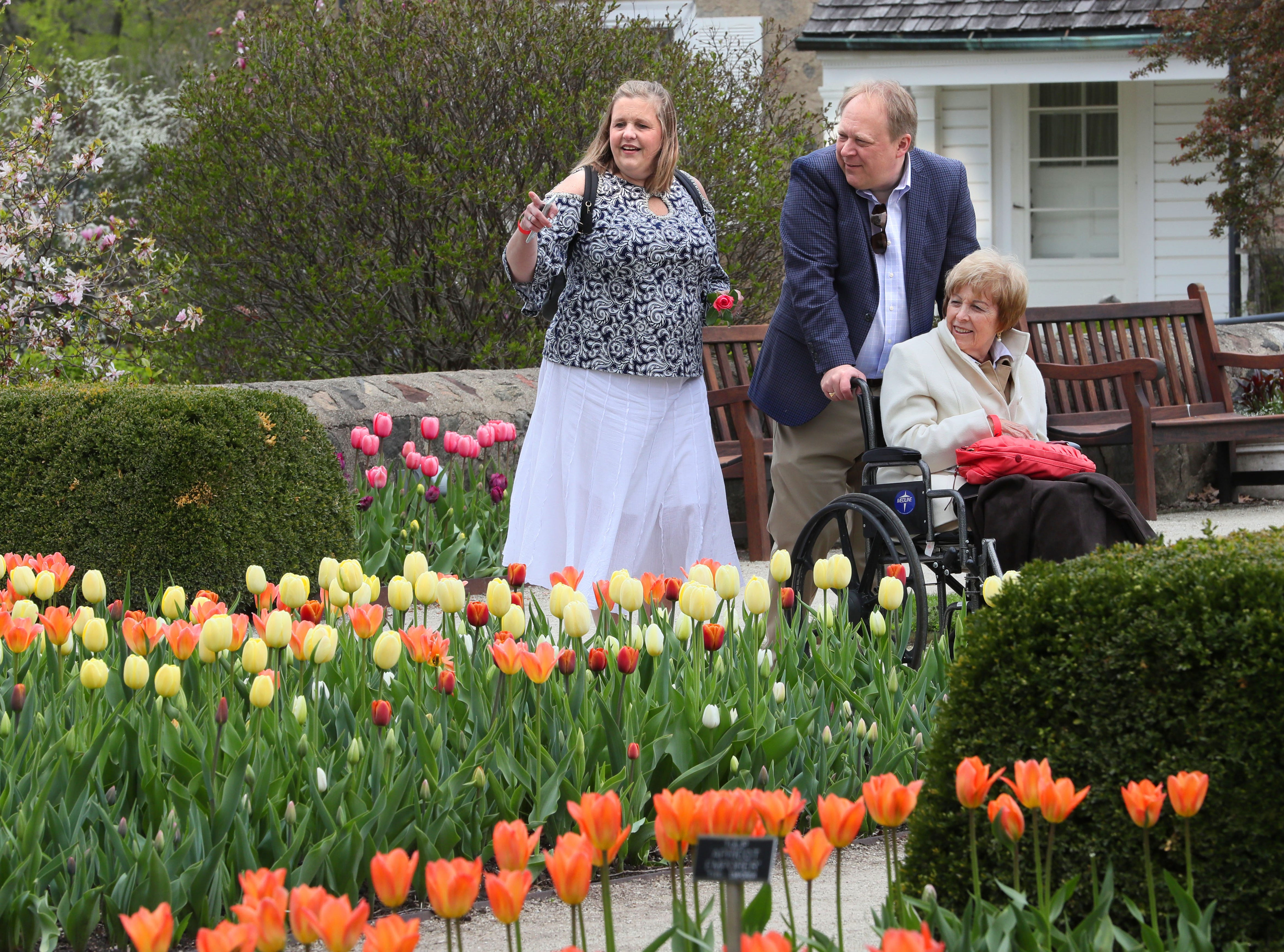 Shara Wagner Grover, left, and husband Stephen Wagner, both of Mukwonago, pointed out flowers to her mother, Ginger Grover of Lake Geneva, as they toured the gardens.