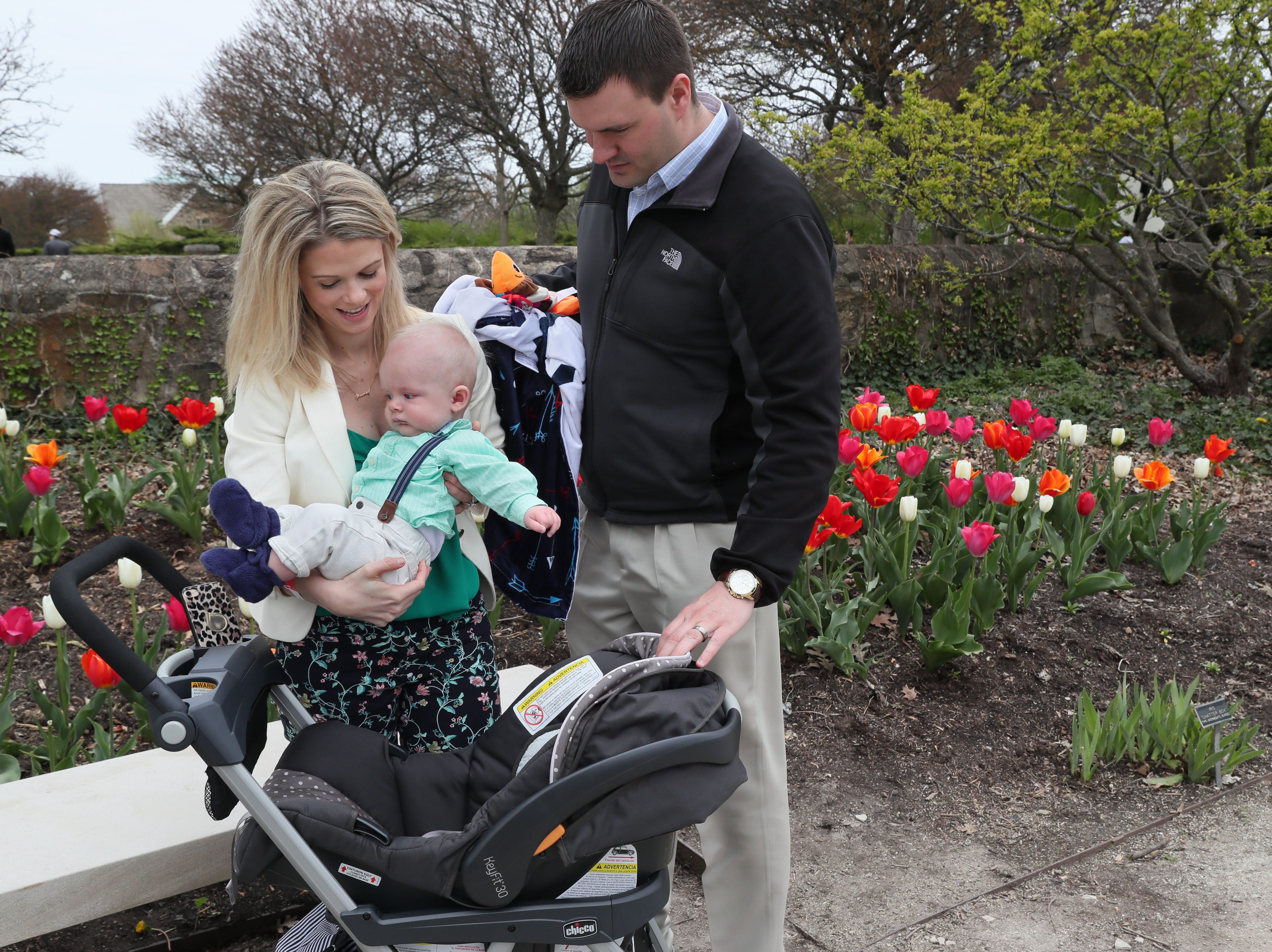 Ashley and Mark Berghuis of Kansasville take their 5-month-old son, Landon, out of his stroller at the Boerner Botanical Gardens for Mother's Day. The event, hosted by the Friends of Boerner Botanical Gardens, included activities for children where they could make gifts for their mothers and grandmothers. A brunch also was available with Zilli Hospitality Group, and the gardens were blooming with spring flowers.