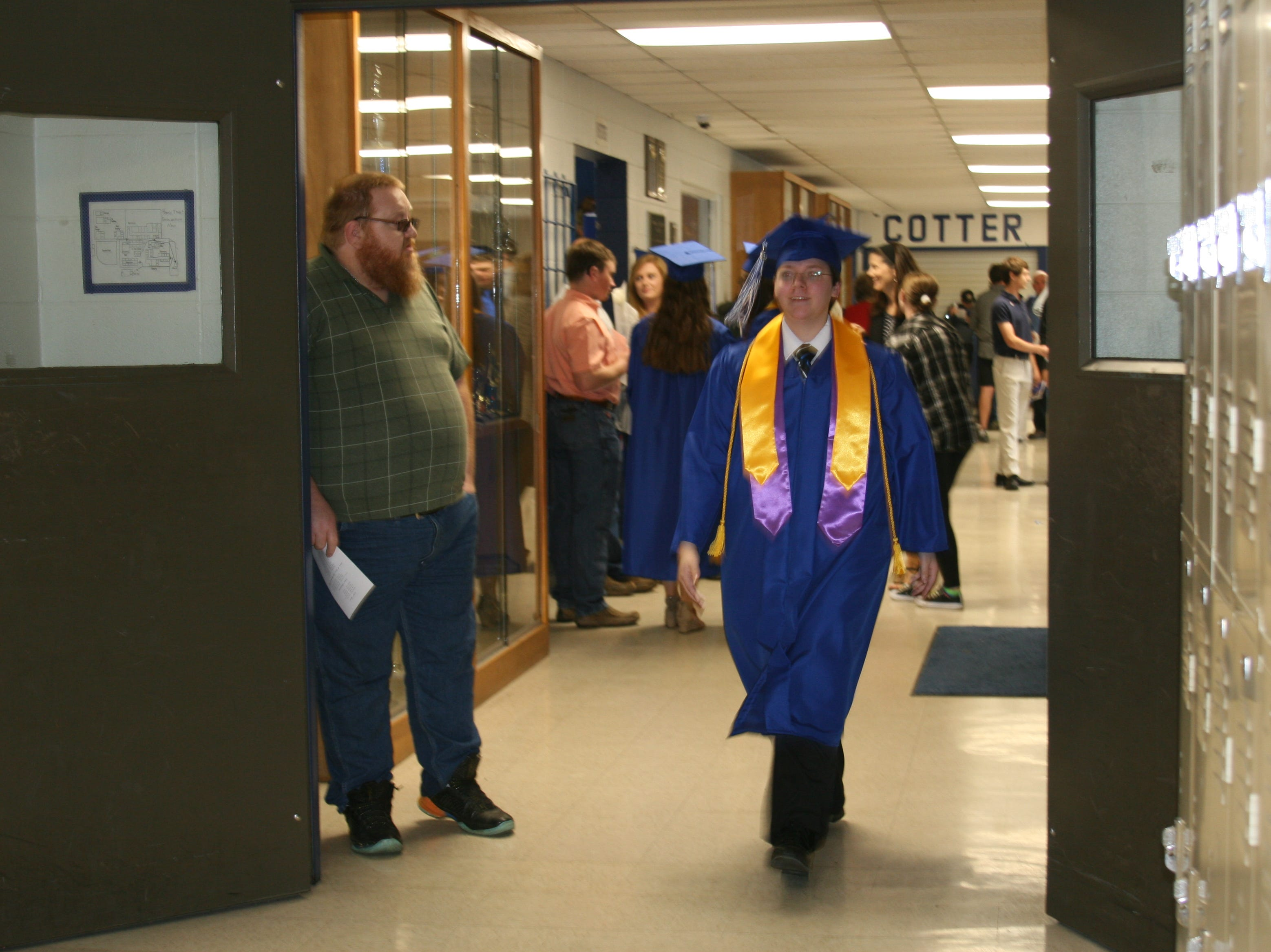 Some students paced the halls of Cotter High School before the 2019 graduation ceremony began.