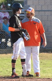 Viola head coach Clayton Gardner talks things over with Carson Guffey during regional tournament play. The Longhorns have advanced to the state semifinal round.