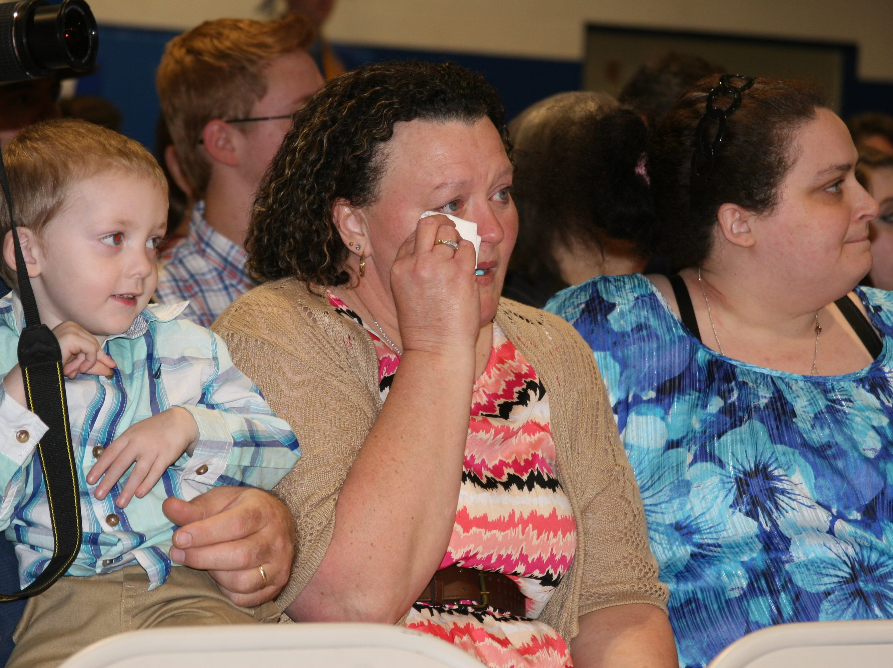 Some parents were overcome with emotion while watching their students walk as part of Saturday night's Cotter High School graduation ceremony on Saturday night.
