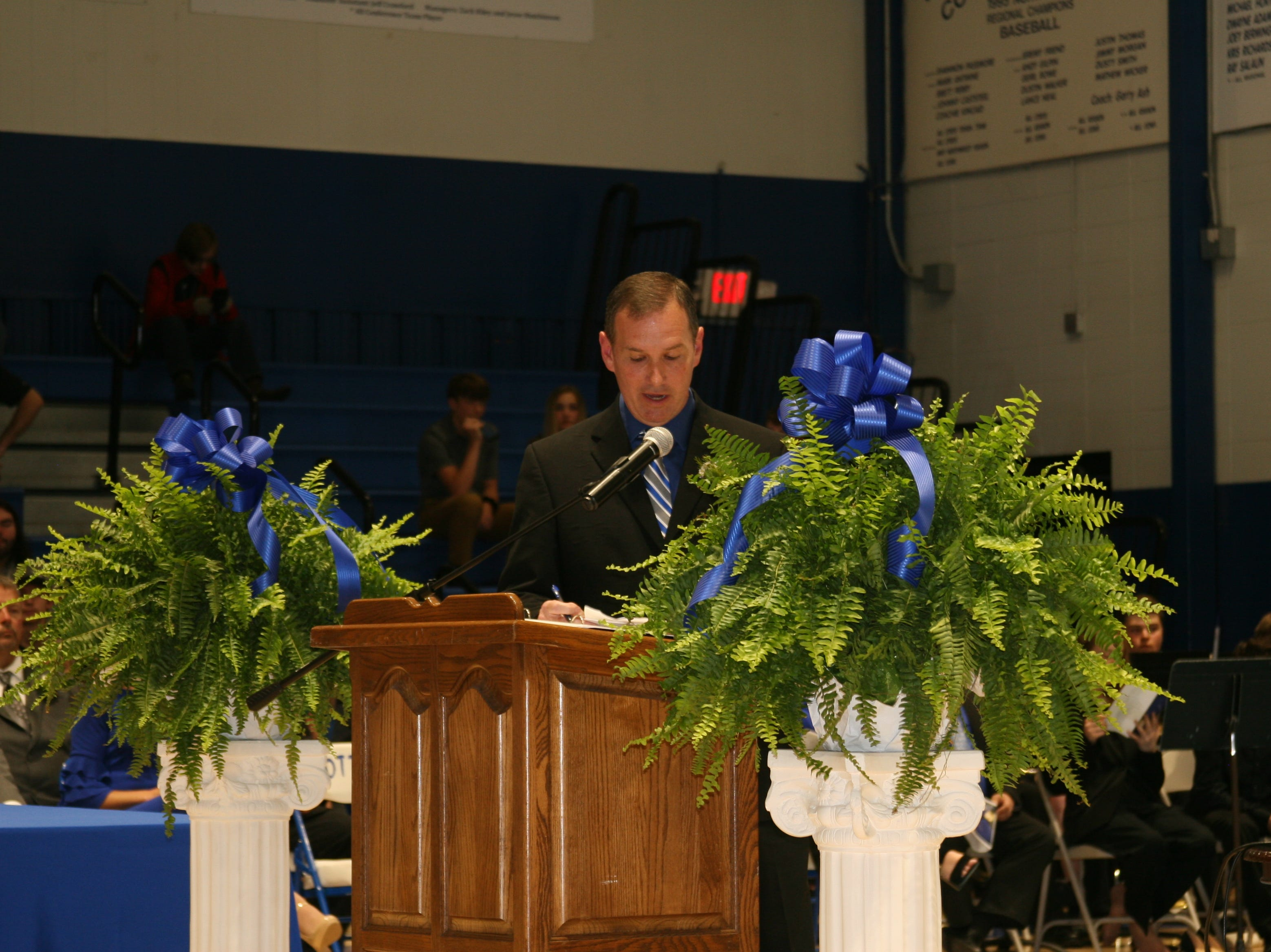 Cotter High School Principal Doug Corley introduces members of the Cotter School Board Saturday night, who presented diplomas to the 61 members of Cotter High School's 2019 graduating class.