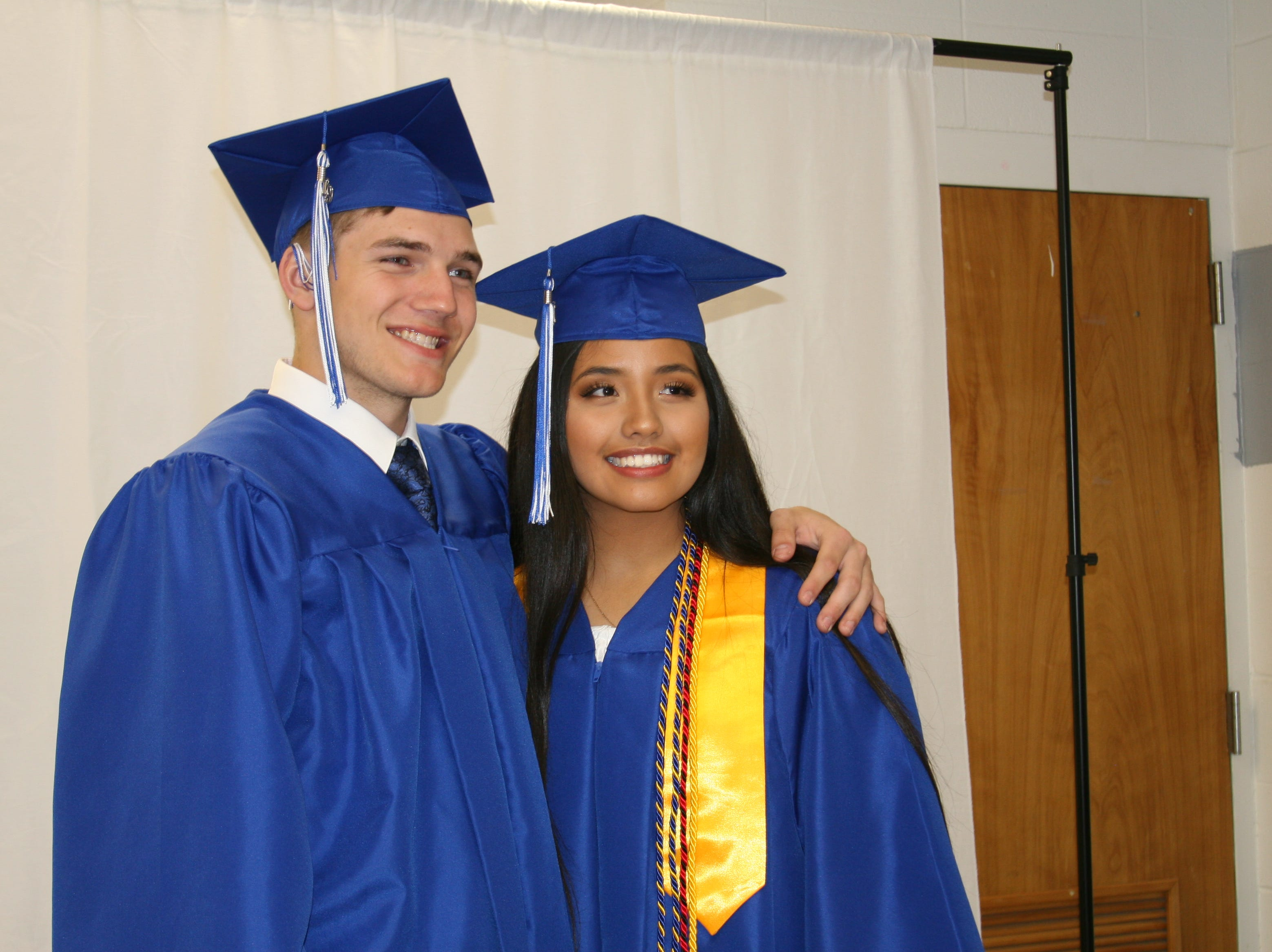 Cotter High School graduates had several backdrops available Saturday night before their graduation ceremony in which they could take photographs with their classmates.