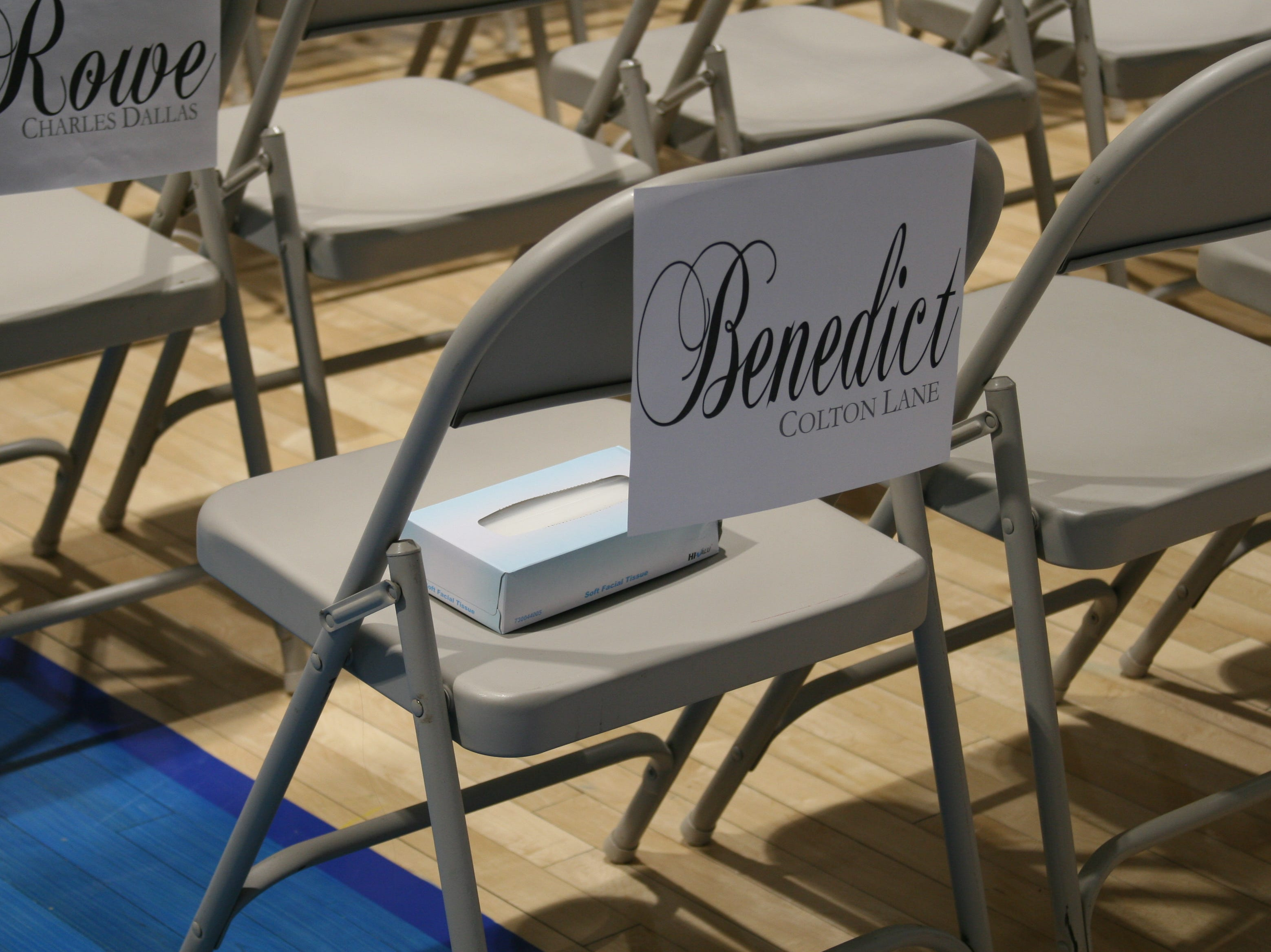 Each row of folding chairs on the gymnasium floor was reserved for the families of each graduate.