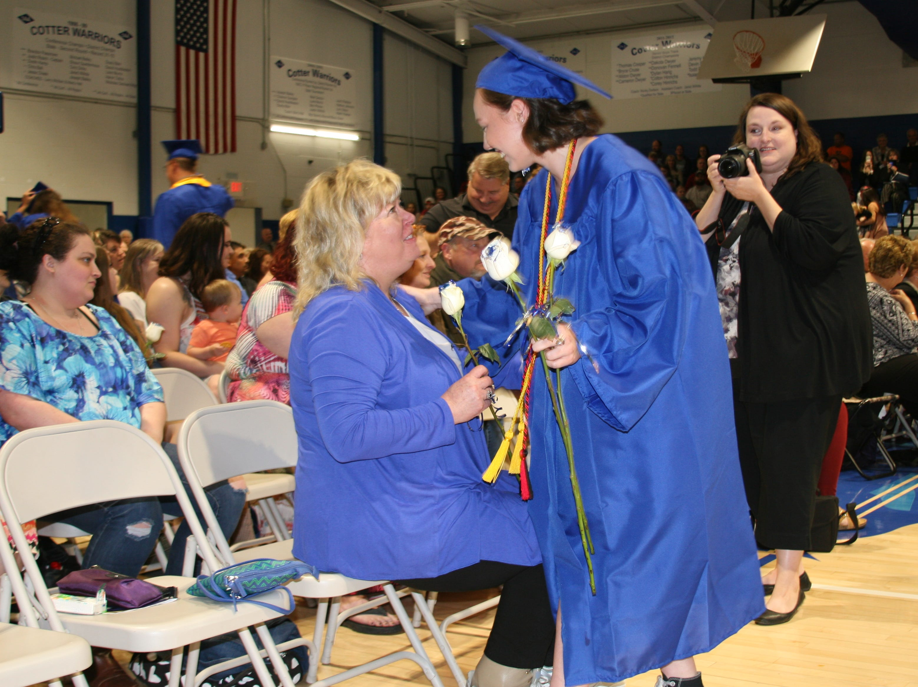 Cotter High School English teacher Sandra Wilhite received a blue and silver rose from a grateful student as part of the presentation of the flowers portion of Saturday night's graduation ceremony.