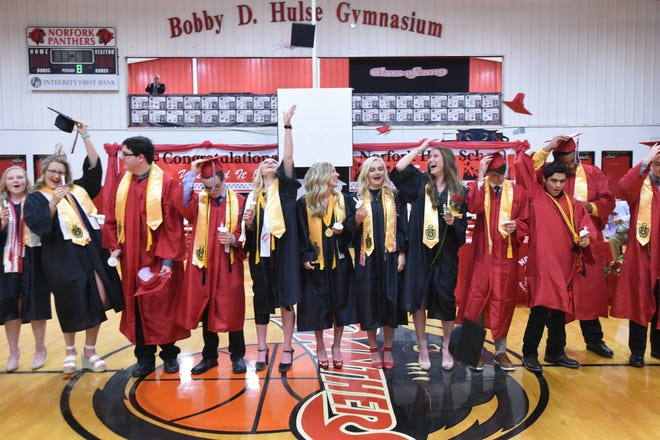 Norfork seniors toss their caps in the air and celebrate Friday night following their graduation ceremony. The school sent 36 graduates out the door this year.