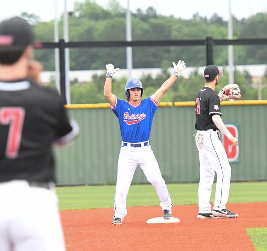 Louisiana Tech sophomore Taylor Young (8) celebrates a hit during Friday night's game versus Western Kentucky at Ruston High School baseball field.
