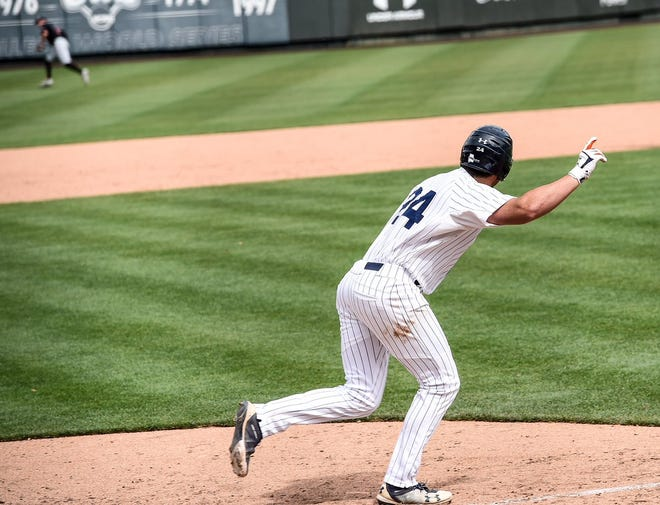 Conor Davis runs toward first base after hitting a walk-off single against Georgia on May 11, 2019, in Auburn, Ala.