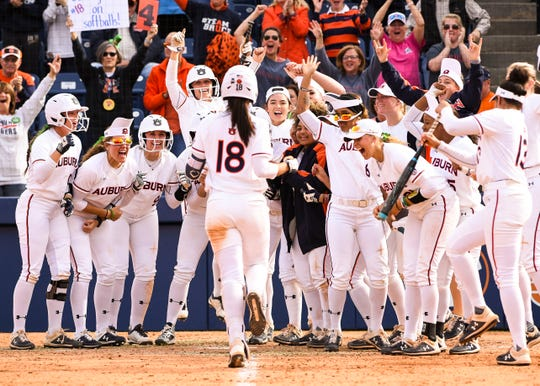 Auburn players celebrate Justus Perry's (18) home run against Texas A&M on Sunday, March 17, 2019, in Auburn, Ala.