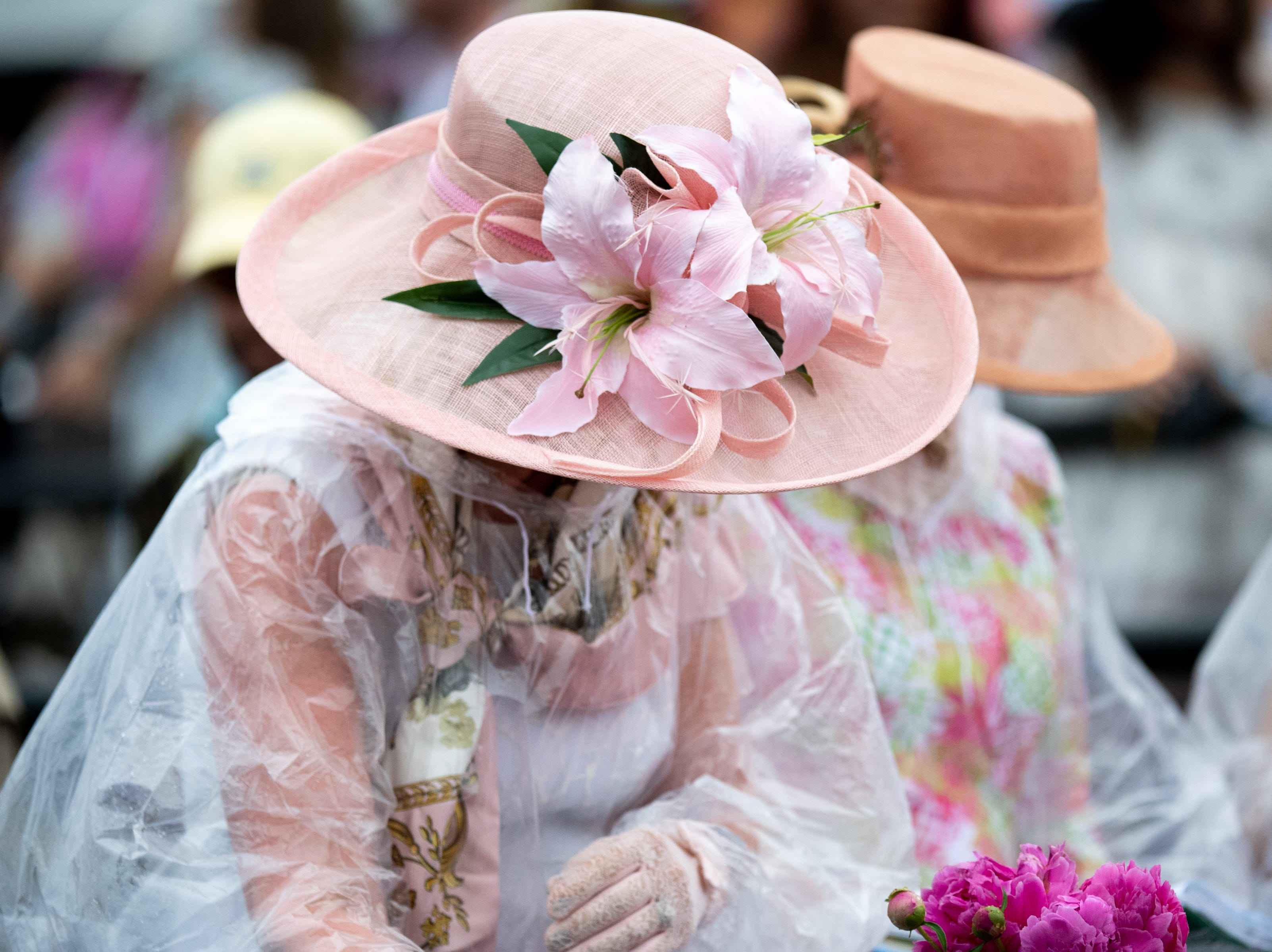 Fans don rain ponchos and large hats during the Iroquois Steeplechase at Percy Warner Park Saturday, May 11, 2019, in Nashville, Tenn.